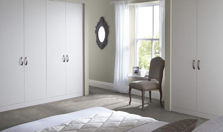 Sliding wardrobe doors uk fitted wardrobes betta living for Fitted bedroom ideas for small rooms
