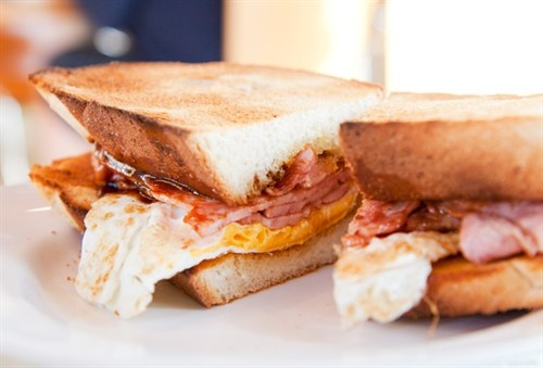 Fried Egg And Bacon Sandwich On Fresh White Bread